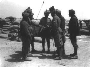 14th Sikhs of the 29th Indian Infantry Brigade examining a piece of shell from 'Asiatic Anne' that fell on their camp, Gallipoli, 1915